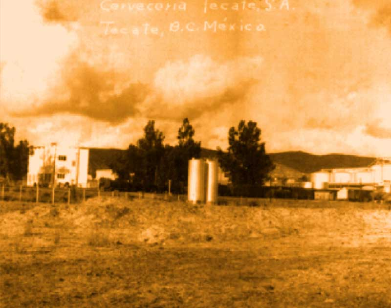 Sepia old picture of Tecate® brewery from a field in Tecate Baja California. Metal containers seen.