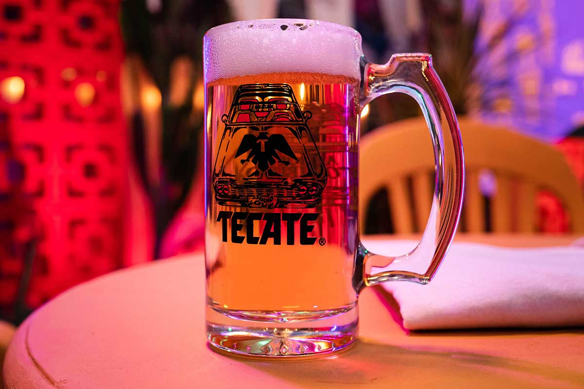 Pint of Tecate beer, the pint was desined by Amor Prohibido LA. Mech colaboration for charity.