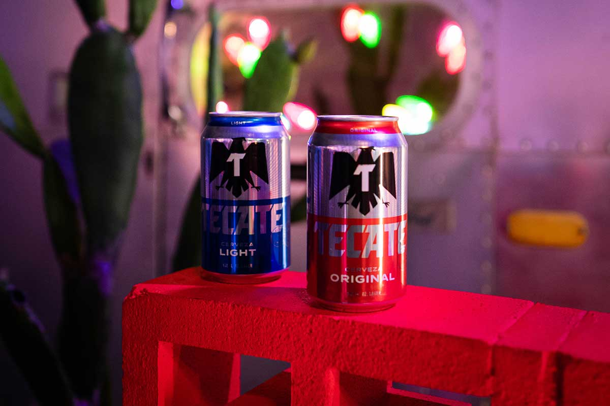 One Tecate® Original can and one Tecate® Light can