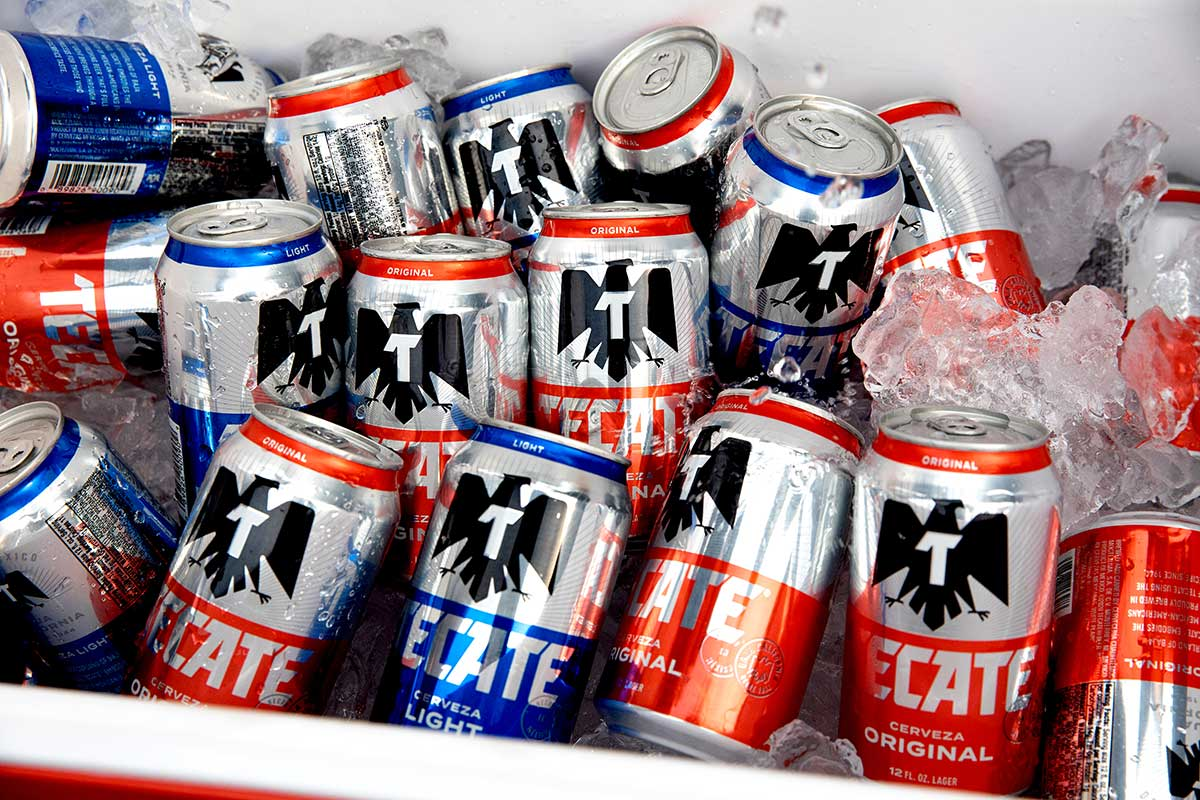 Tecate® Light and Original cans in a cooler