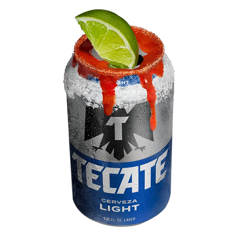 Tecate® Light can with a lime, salt and some hot sauce on top.