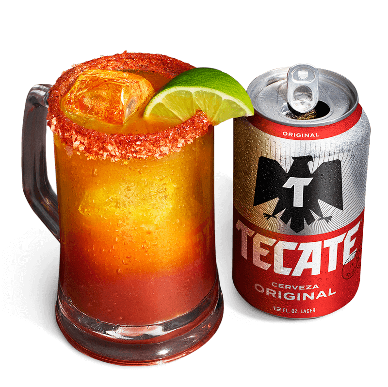 A mug of mixed Tecate® Original with clam juice, a lime and ice.