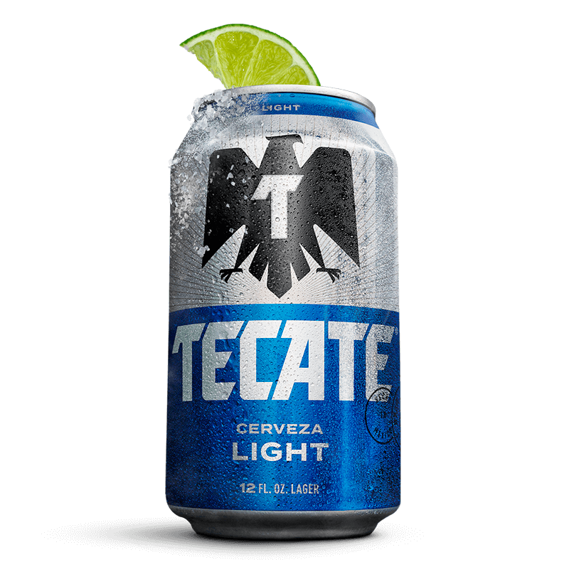Open can of Tecate® Light with salt on the rim and two limes next to it.